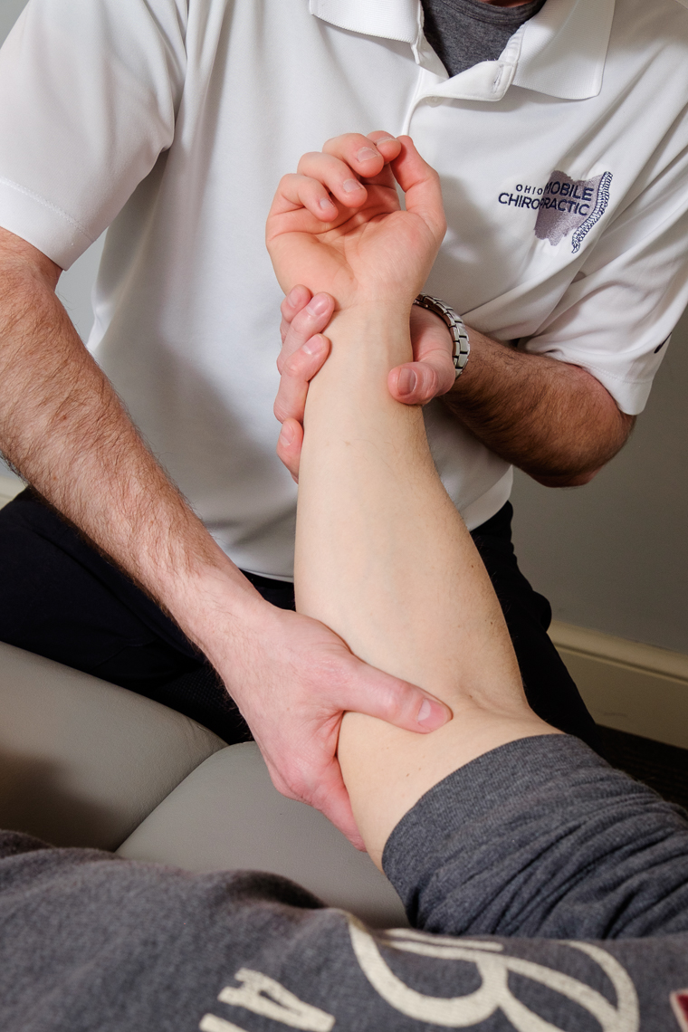 A chiropractor working on a client