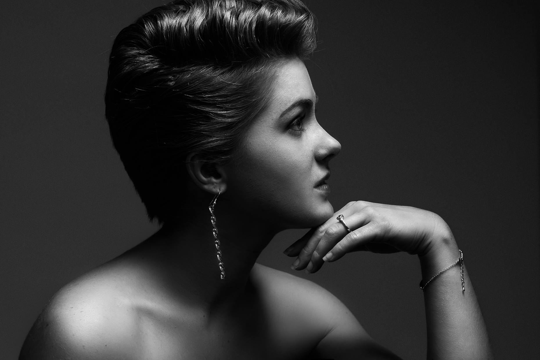 Commercial black and white portrait of a young woman in profile.