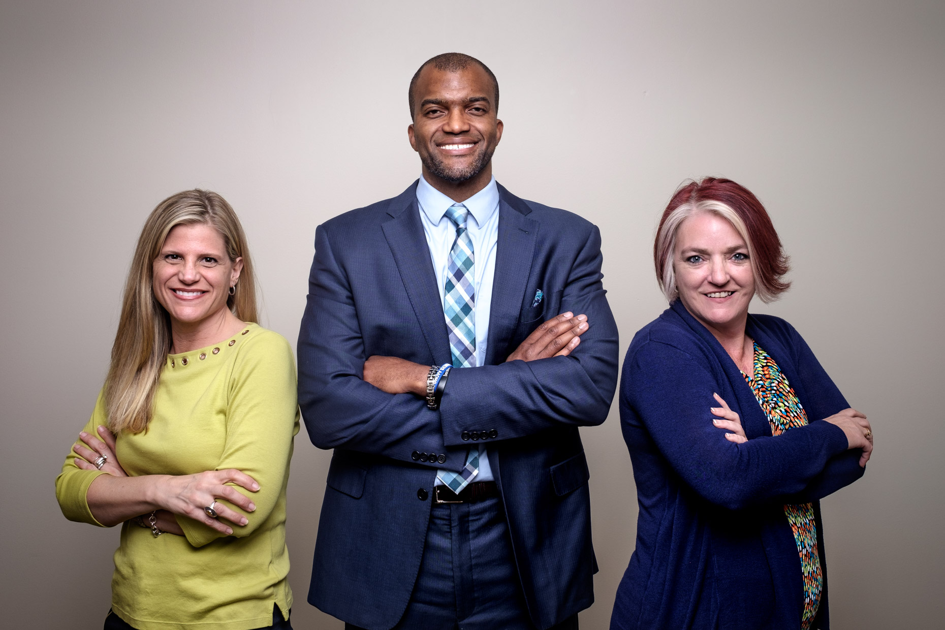 Group business image of three farmers insurance professionals.