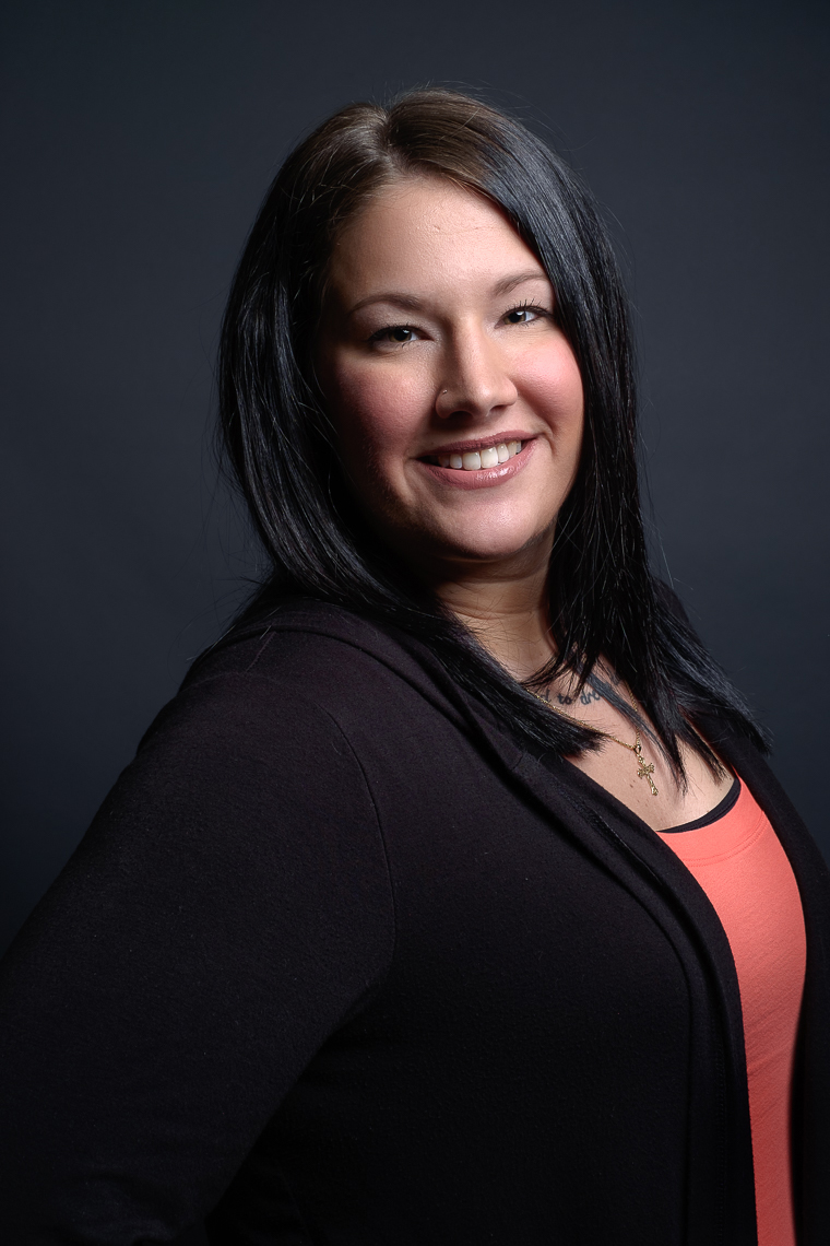 Business headshot of a female insurance professional.