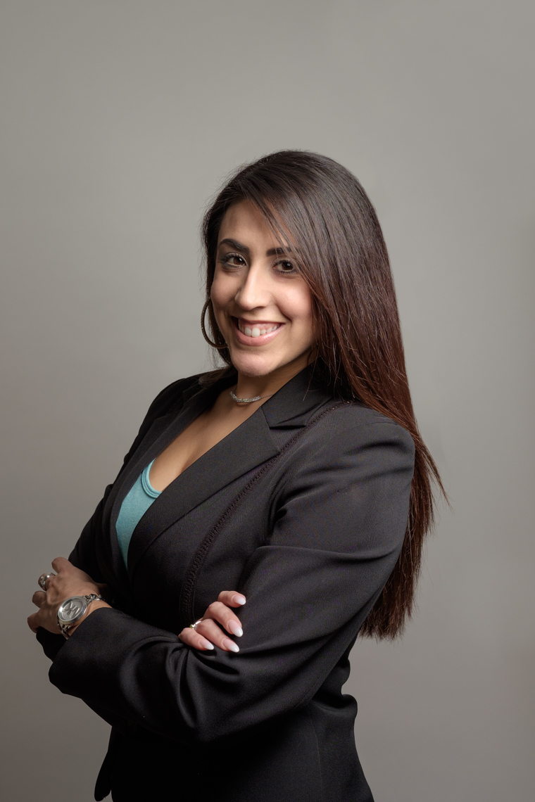 Business headshot of a female professional looking at the camera.