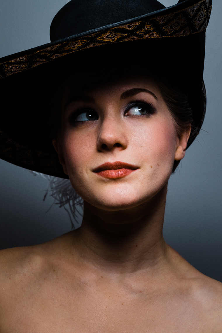 Commercial portrait of a woman with a hat.