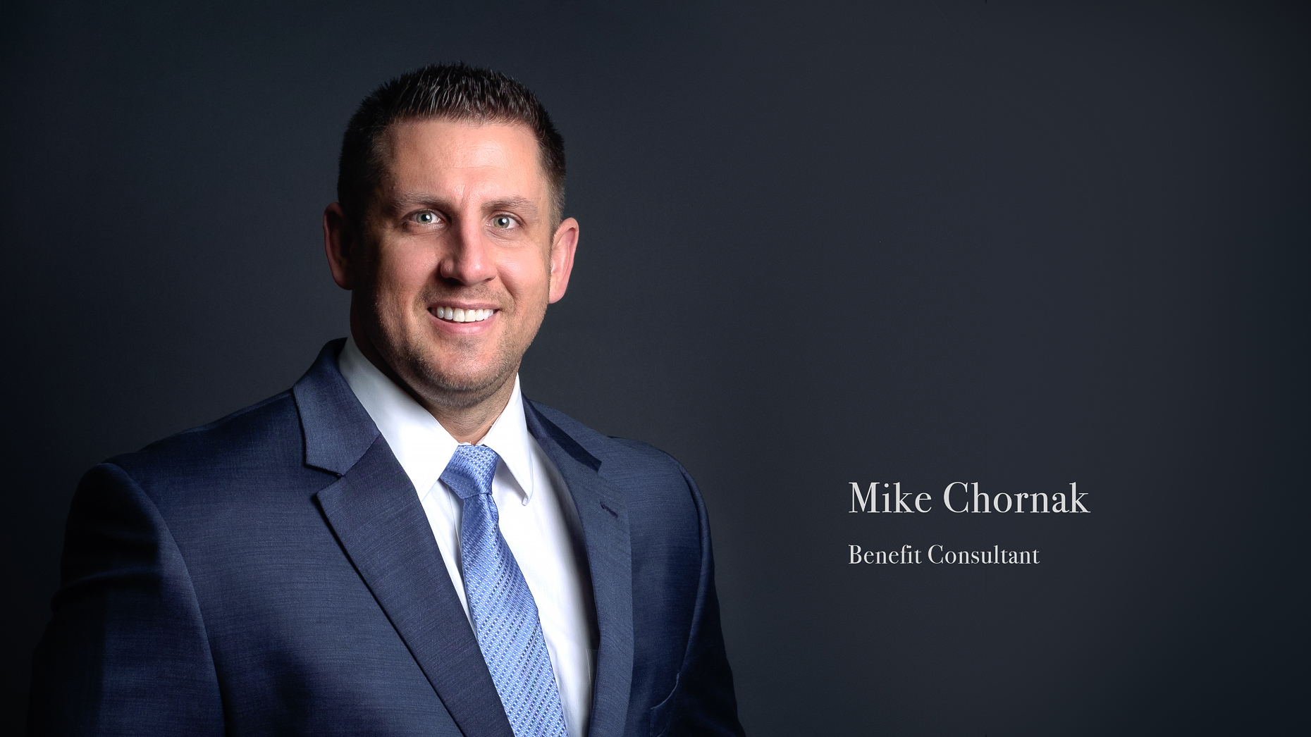 Business headshot of a male insurance professional with their title on the image.