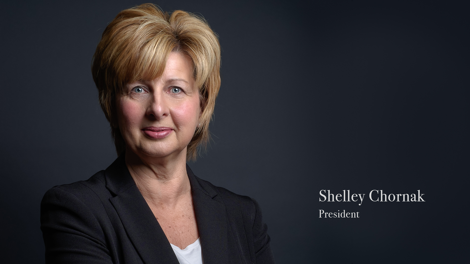 Business headshot of a female insurance professional with their title on the image.